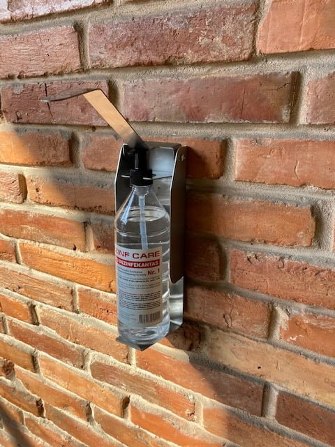 Hand sanitizer wall dispenser